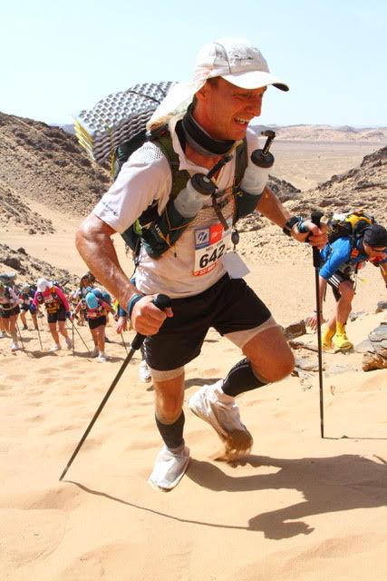 Neil climbing a sand dune fueled by yockenthwaite granola
